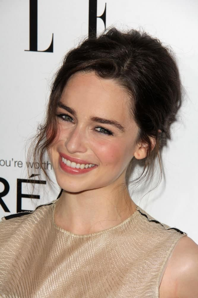 "Emilia Clarke smiles at the Elle 20th Annual ""Women In Hollywood"" Event, Four Seasons Hotel, Beverly Hills, CA on Oct. 21, 2013."
