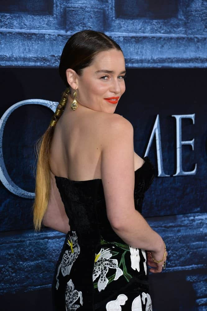 Emilia Clarke poses her side profile at the season 6 premiere of Game of Thrones 2016.
