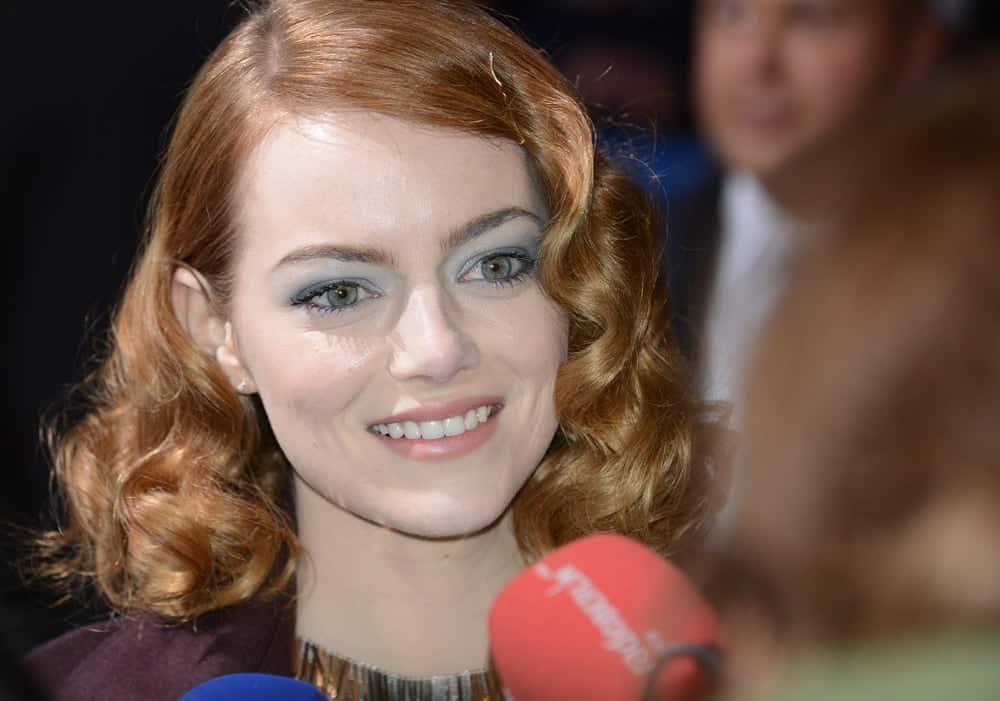 "Emma Stone was at ""The Amazing Spider-Man 2"" premiere at CineStar, Sony Center, Potsdamer Platz on April 15, 2014 in Berlin, Germany. She was stunning with her short and curly pinned hairstyle and bright smile."
