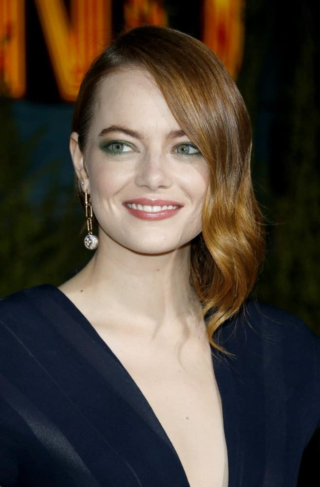 Actress Emma Stone was at the Los Angeles premiere of 'Zombieland Double Tap' held at the Regency Village Theatre in Westwood on October 10, 2019. She was stunning in her navy blue outfit that complemented her stylish side-swept waves.