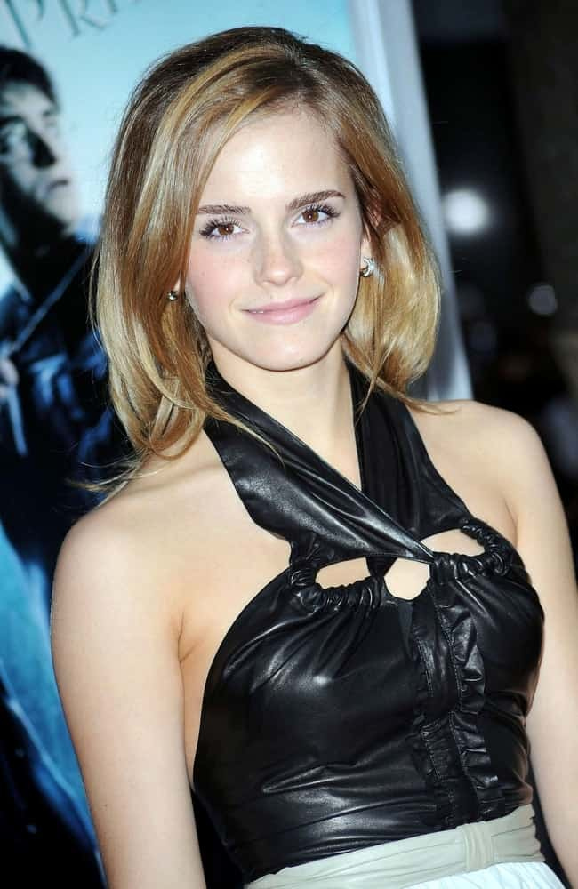 "Emma Watson wore a black leather Proenza Schouler dress at the ""Harry Potter and the Halfblood Prince"" Premiere held at The Ziegfeld Theatre in New York, NY on July 9, 2009. She paired this with a shoulder-length tousled hairstyle with layers."
