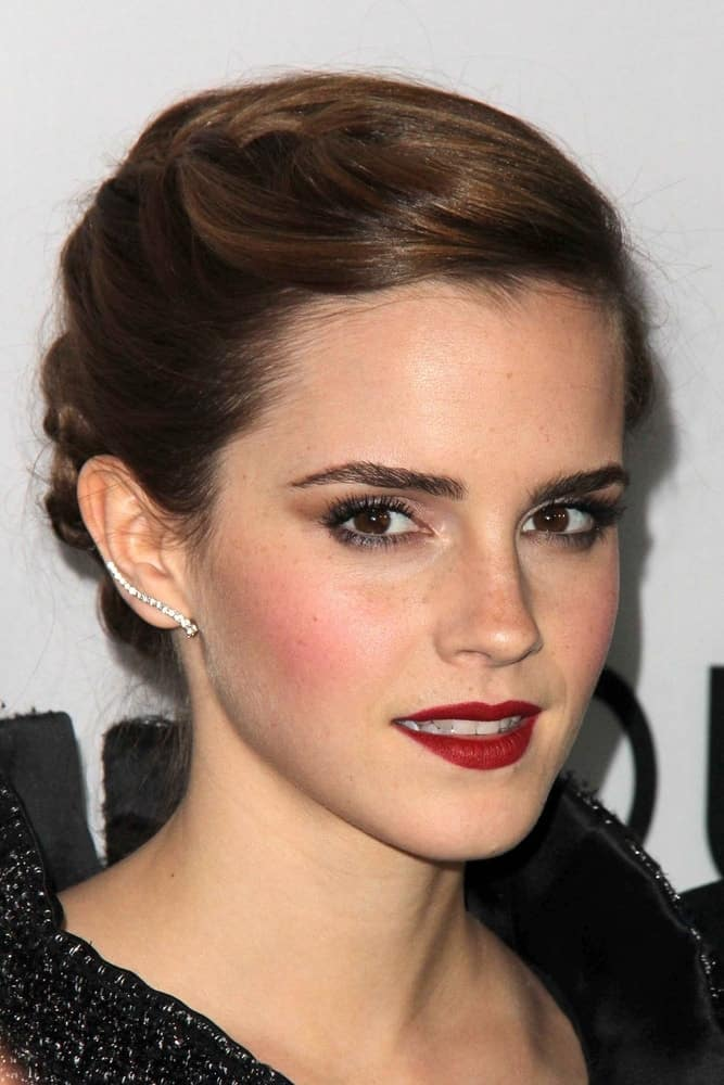 "Emma Watson was at the ""The Bling Ring"" Los Angeles Premiere at the DGA Theater on June 4, 2013, in Los Angeles, CA. Her lovely red lips paired well with her black outfit and elegant upstyle incorporated with braids."