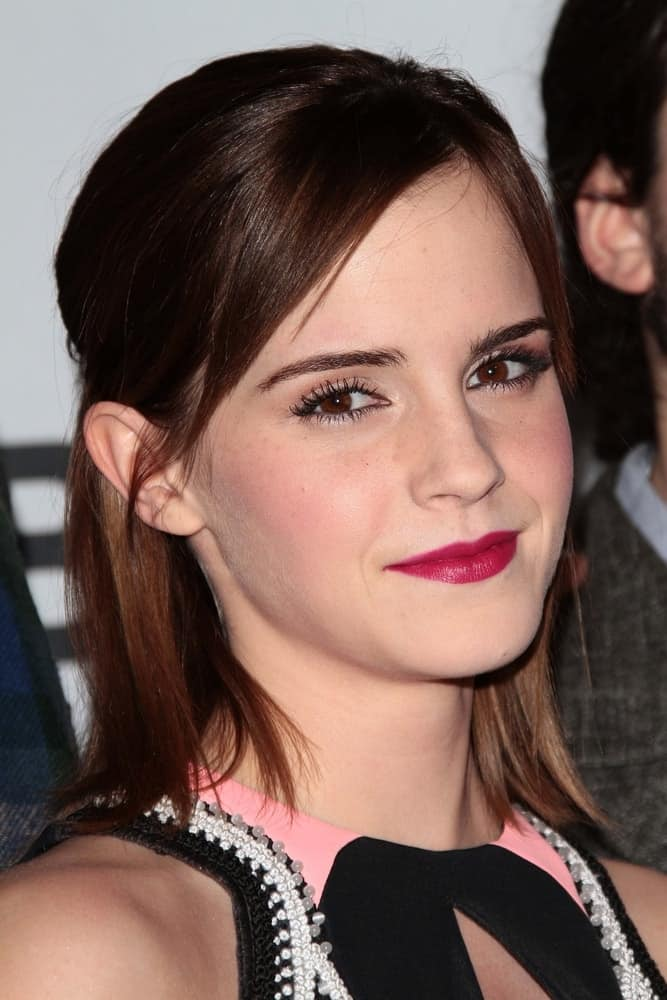 Emma Watson paired her colorful dress with a shoulder-length half-up hairstyle with side-swept bangs at the 2013 People's Choice Awards Press Room, Nokia Theatre in Los Angeles, CA on January 9, 2013.