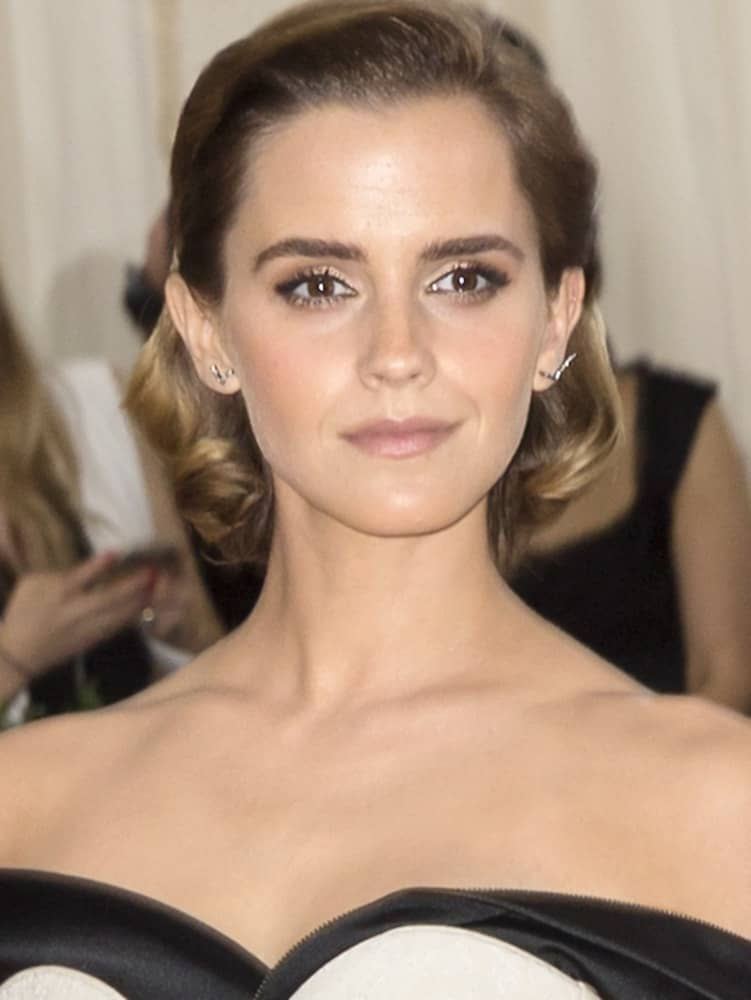 On May 2, 2016, Emma Watson attended the Manus x Machina Fashion in an Age of Technology Costume Institute Gala at the Metropolitan Museum of Art. She wore an elegant and fashionable black and white outfit that she paired with a short half-up hairstyle with a curl at the tips.