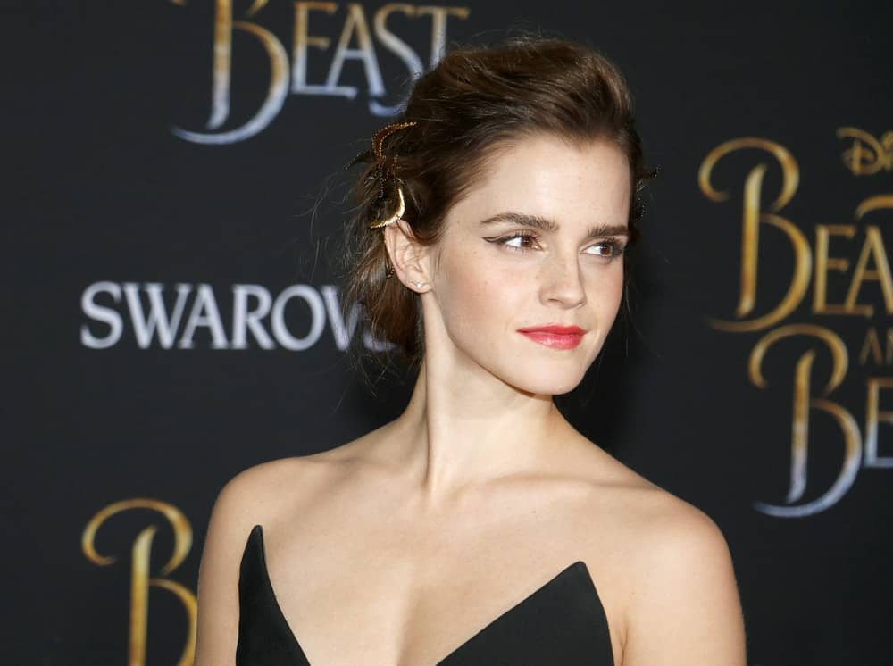 Emma Watson flaunted her beautiful neckline with a strapless black dress and a tousled low bun hairstyle with pins at the Los Angeles premiere of 'Beauty And The Beast' held at the El Capitan Theatre in Hollywood on March 2, 2017.