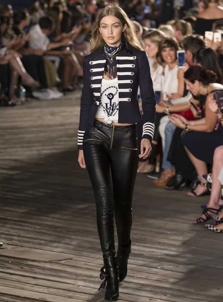 Gigi Hadid walked the runway at Tommy Hilfiger Women's Fashion Show during New York Fashion Week at Pier 19 On September 9, 2016 in New York. She looked sexy in her black leather pants and long wavy tousled hairstyle.