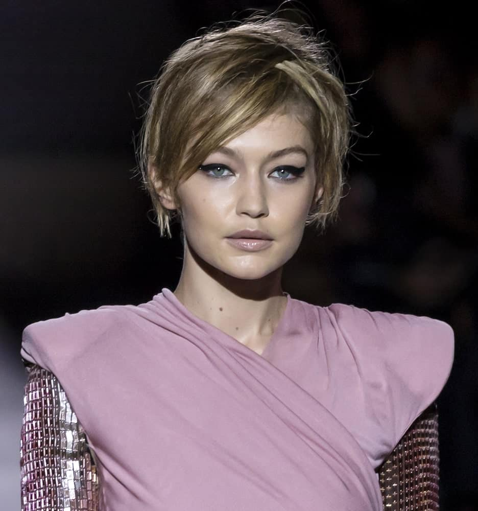 On September 06, 2017, Gigi Hadid had a short hairstyle with messy side-swept bangs when she walked the runway at the Tom Ford Spring Summer 2018 fashion show during the New York Fashion Week.