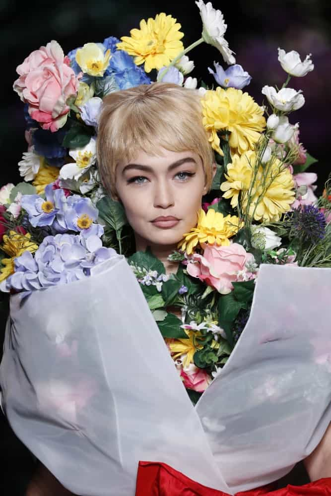 Gigi Hadid was dressed as a bouquet of flowers with her blond pixie hairstyle at the runway of the Moschino Spring/Summer 2018 fashion show on September 21, 2017 in Milan, Italy.