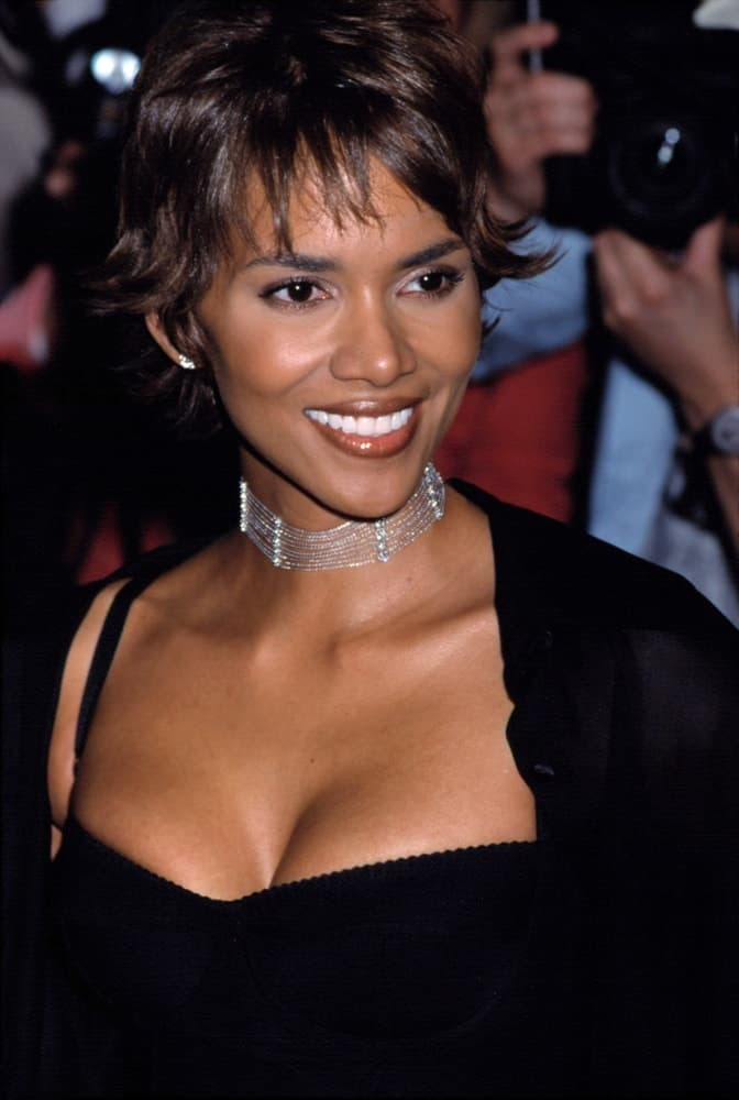 Halle Berry was at the premiere of SWORDFISH in New York on May 11, 2001. She came wearing a black sexy outfit to go with her flippy spiked short hair with short wispy bangs.