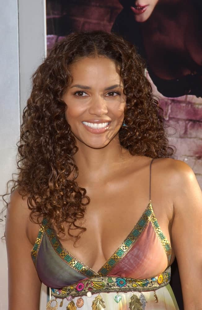 Actress Halle Berry was quite stunning in her colorful sexy dress and loose tousled long curly hairstyle at the world premiere of her new movie Catwoman in Hollywood on July 19, 2004.