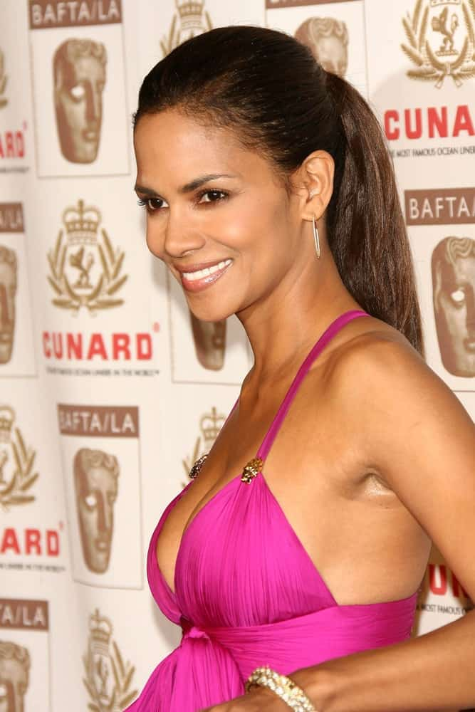 Halle Berry was at the 2005 BAFTA/LA Cunard Britannia Awards at Hyatt Regency Century Plaza Hotel on November 2, 2006, in Century City, CA. She was quite stunning in her sexy purple dress and slick high ponytail hairstyle.