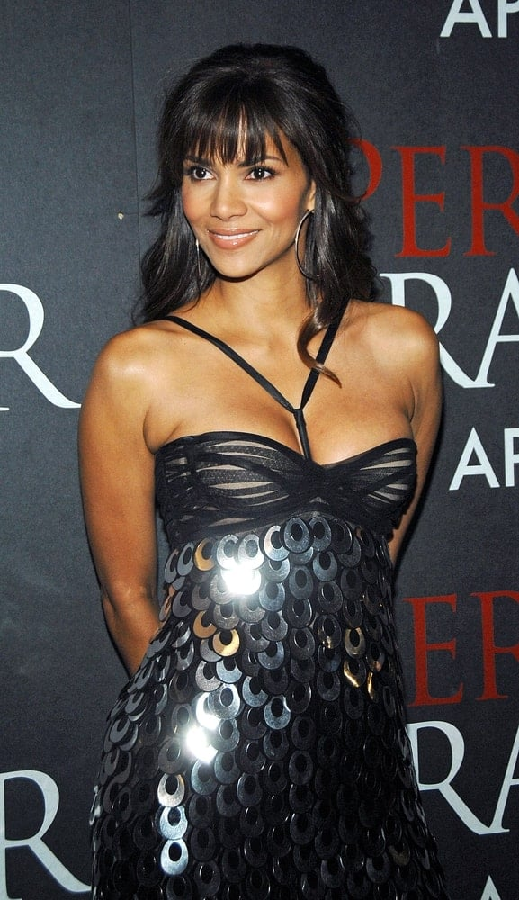 """Halle Berry wowed everyone with her fashionable shiny black dress and long layered hairstyle that has blunt bangs and wavy tips at the New York Premiere of """"Perfect Stranger"""" in New York, NY on April 10, 2007."""