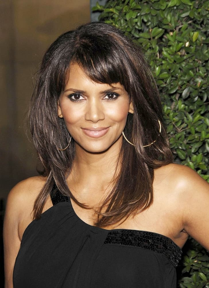 "Halle Berry attended the ""Things We Lost in the Fire"" LA Premiere held at the Mann's Egyptian Theater in Los Angeles, CA on October 15, 2007. She came wearing a lovely black dress to pair with her thick, layered and tousled hairstyle loose on her shoulders."