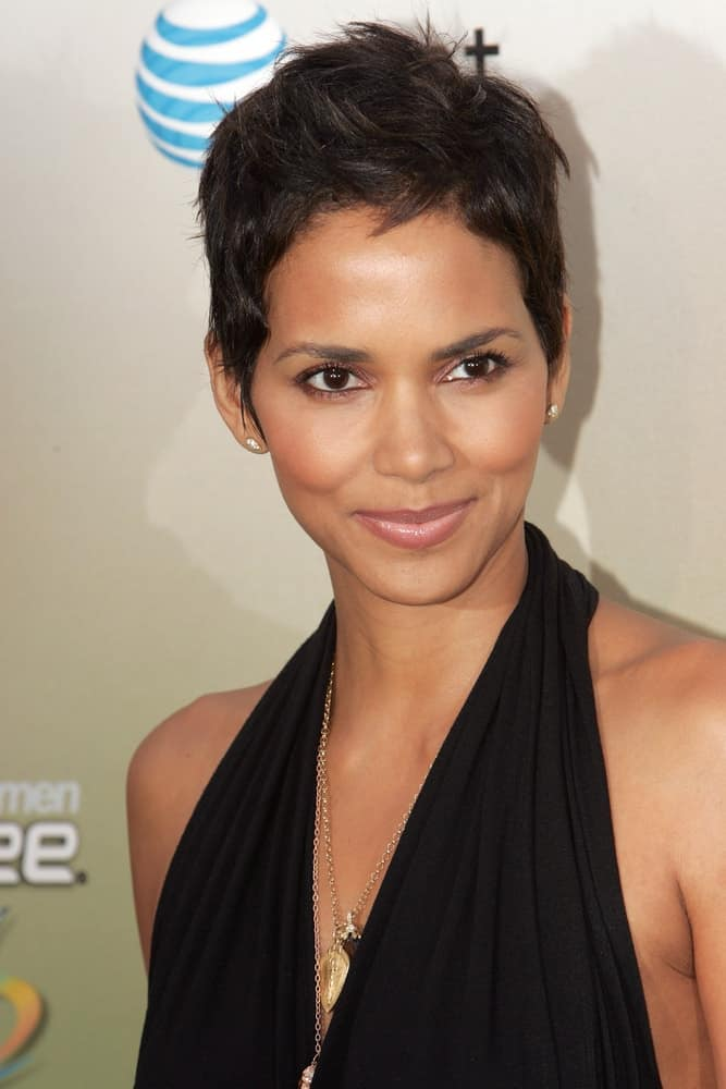 Actress Halle Berry wore a classy black dress to match her sexy side-swept pixie hairstyle with spikes at the 2009 Spike TV Guys Choice Awards at Sony Studios on May 30, 2009, in Los Angeles.