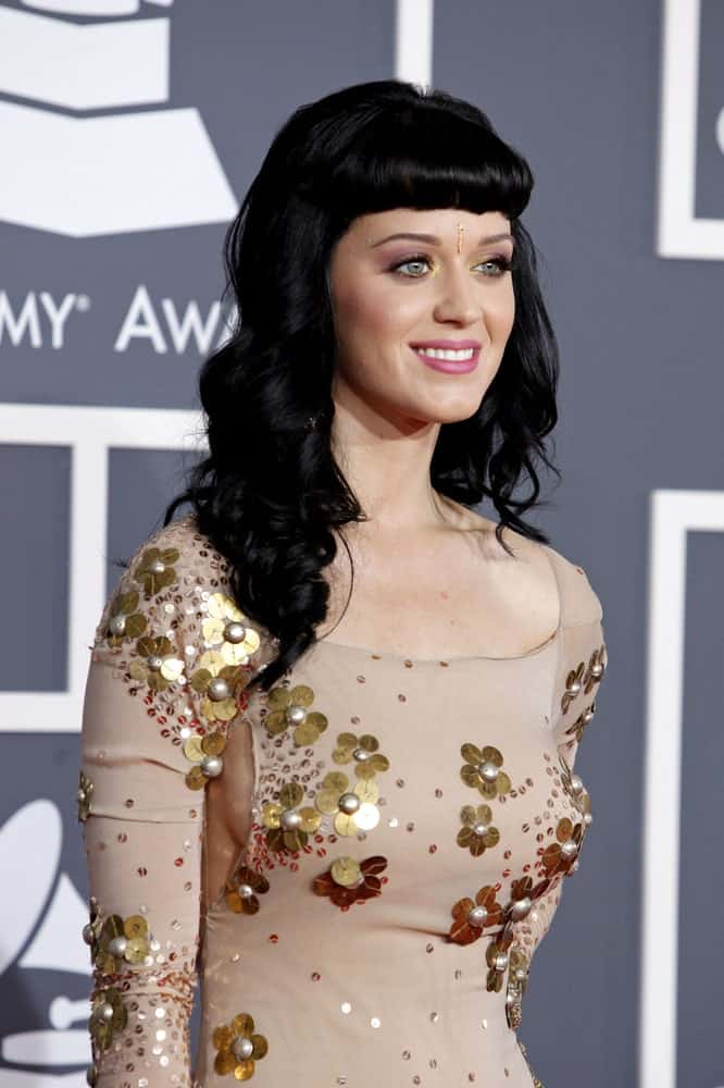 Katy Perry had long black curls with short blunt bangs at the 52nd Annual GRAMMY Awards held at Staples Center in Los Angeles, California on January 31, 2010.