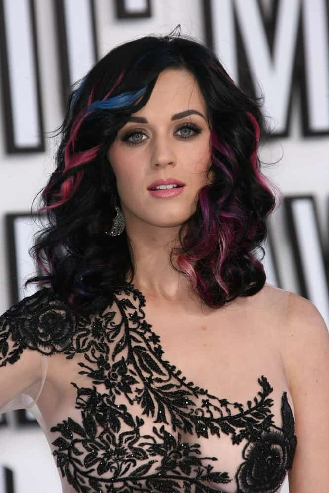 Katy Perry exhibited an edgy look with her dark curls accentuated with blue and pink highlights during the 2010 MTV Video Music Awards at Nokia Theatre L.A. LIVE on August 12, 2010.