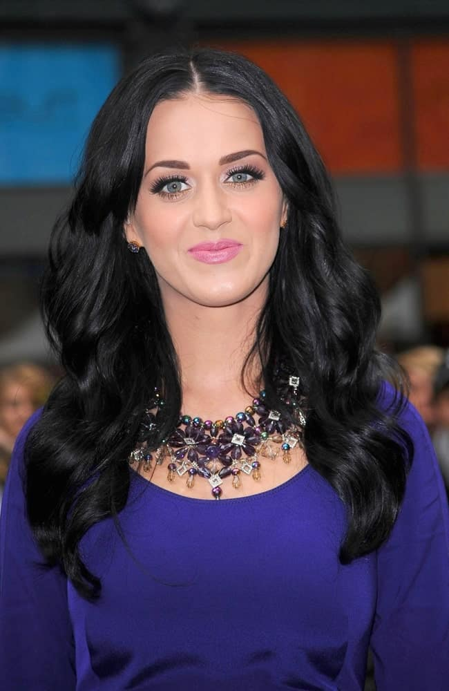Katy Perry showcased her voluminous center-parted curly hair that's paired with a statement necklace during the Launch of Purr Fragrance by Katy Perry for Nordstrom Pop-Up NYC Event on November 16, 2010.