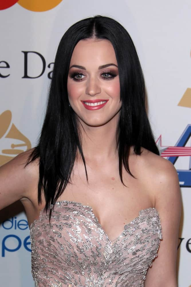 Katy Perry pulled off a simple loose hairstyle with subtle layers and middle parting at the 2011 Pre-GRAMMY Gala And Salute To Industry Icons at Beverly Hilton Hotel on February 12, 2011.
