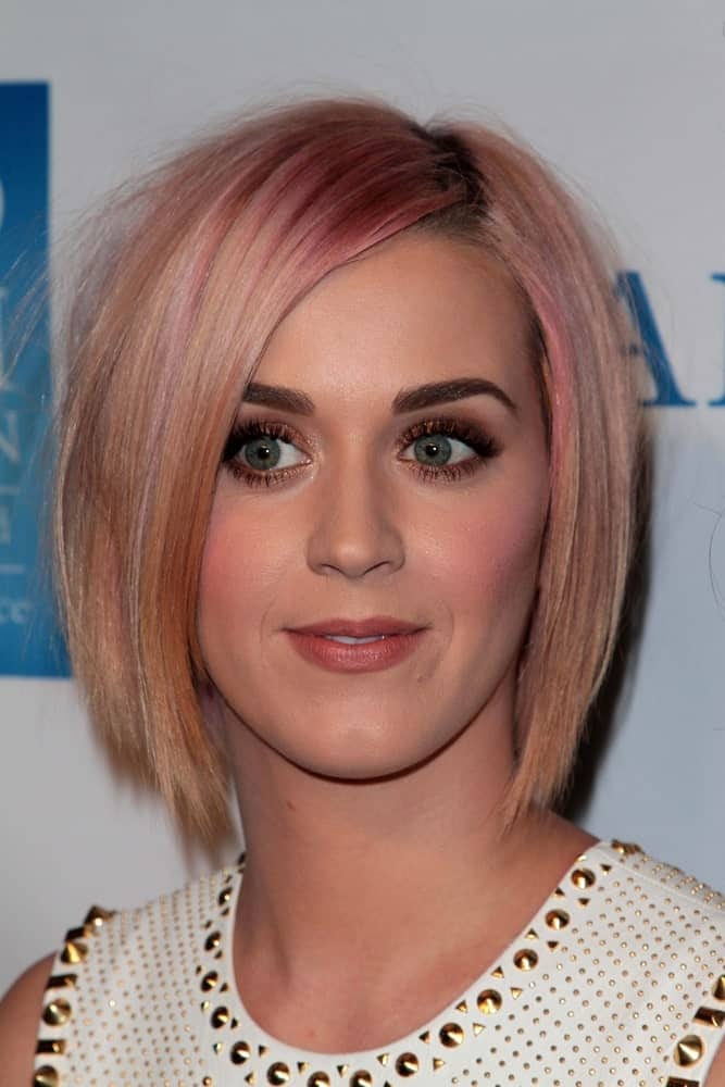 "Katy Perry opted for a short layered bob in light pink during the 3rd Annual ""Change Begins Within"" Benefit Celebration on December 3, 2011."