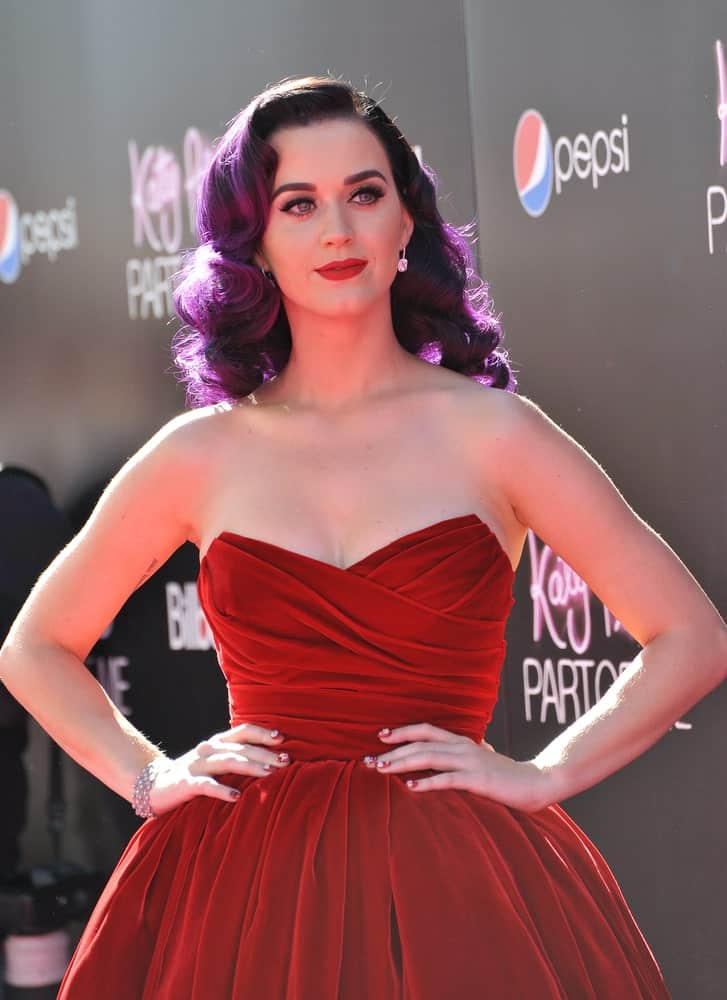 "Katy Perry displayed a bold look with her red dress and purple curls during the premiere of her new movie ""Katy Perry: Part of Me"" at Grauman's Chinese Theatre, Hollywood on June 27, 2012."