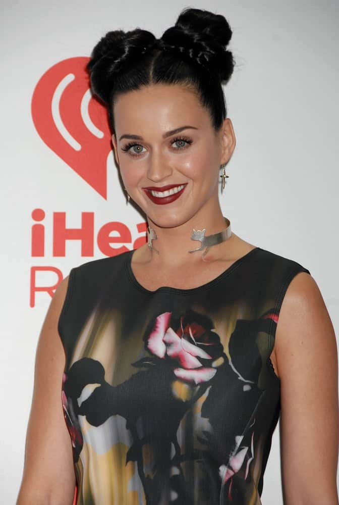 Katy Perry styled her thick black locks with braided pigtail buns during the iHeartRadio Music Festival on September 20, 2013 in Las Vegas, NV.