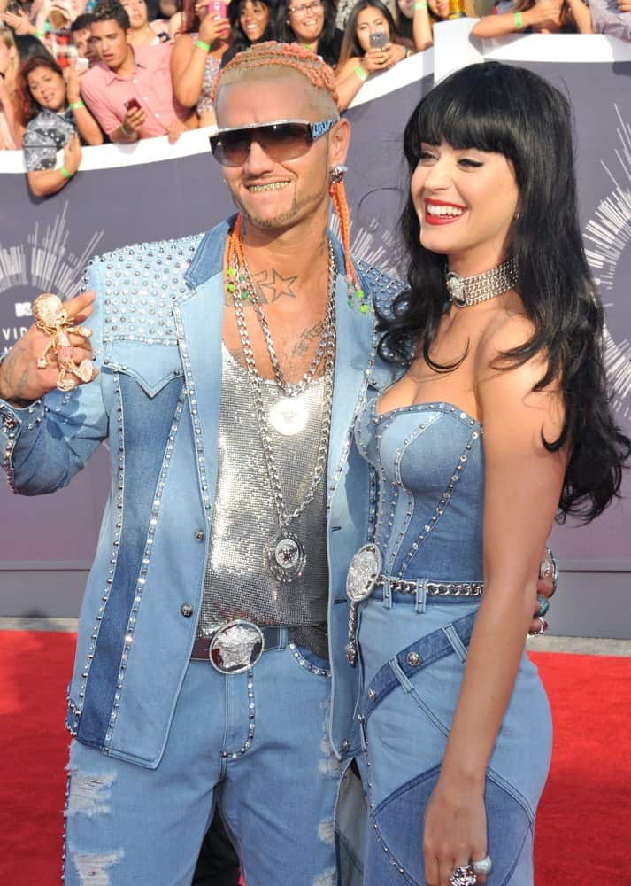 Katy Perry with Riff Raff at the 2014 MTV Video Music Awards held at The Forum, Los Angeles on August 24, 2014. Katy wore a matching denim outfit paired with her long layered hair that's incorporated with blunt bangs.