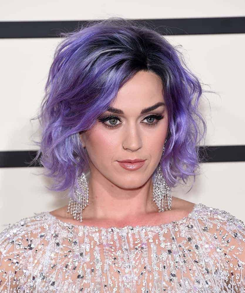 Katy Perry rocks a purple tousled hairstyle to complement her crystal-embellished sheer dress at the Grammy Awards 2015. A really unique short hairstyle for a playful artist like her!