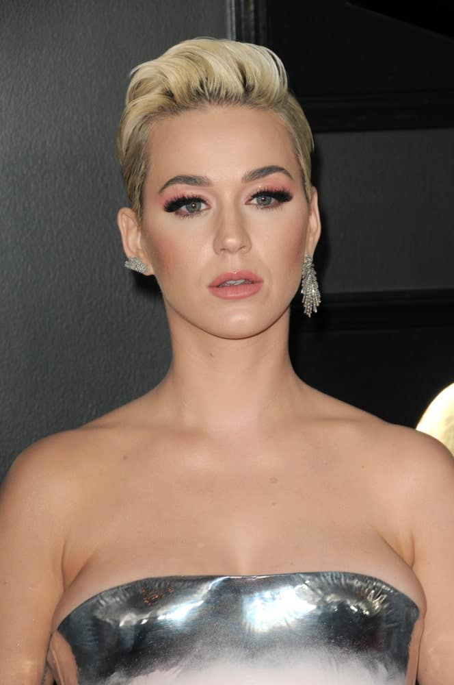 The actress opted for a slicked-back hairstyle with short sides at the 61st Grammy Awards at the Staples Center on February 10, 2019. She finished the look with a silver tube dress and mismatched earrings.