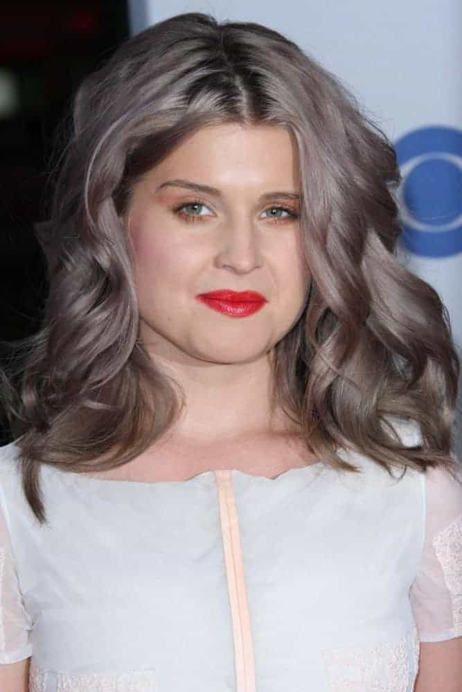 A fabulous-looking Kelly Osbourne with her gorgeous hairstyle and color, perfectly paired with her white dress. Photo taken on January 11, 2012.