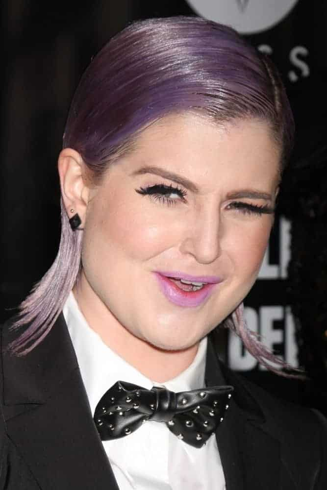 "Kelly Osbourne stole so many eyes at the ""RuPaul's Drag Race"" Season 6 Premiere Party at Hollywood Roosevelt Hotel with her black suit outfit and purple hair. Photo taken on February 17, 2014."