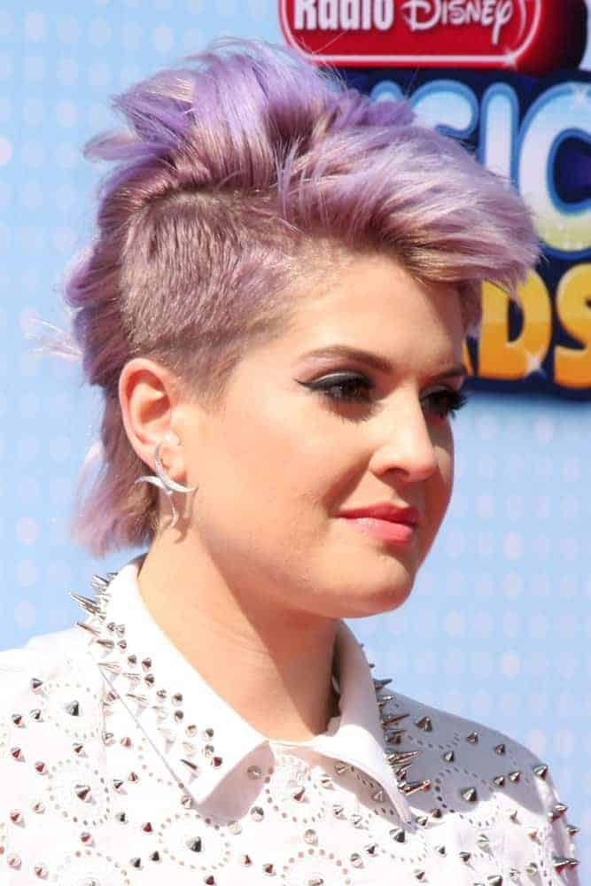 A bold and fierce Kelly Osbourne, still with her iconic purple hair at the April 16, 2014 Radio Disney Music Awards at Nokia Theater.