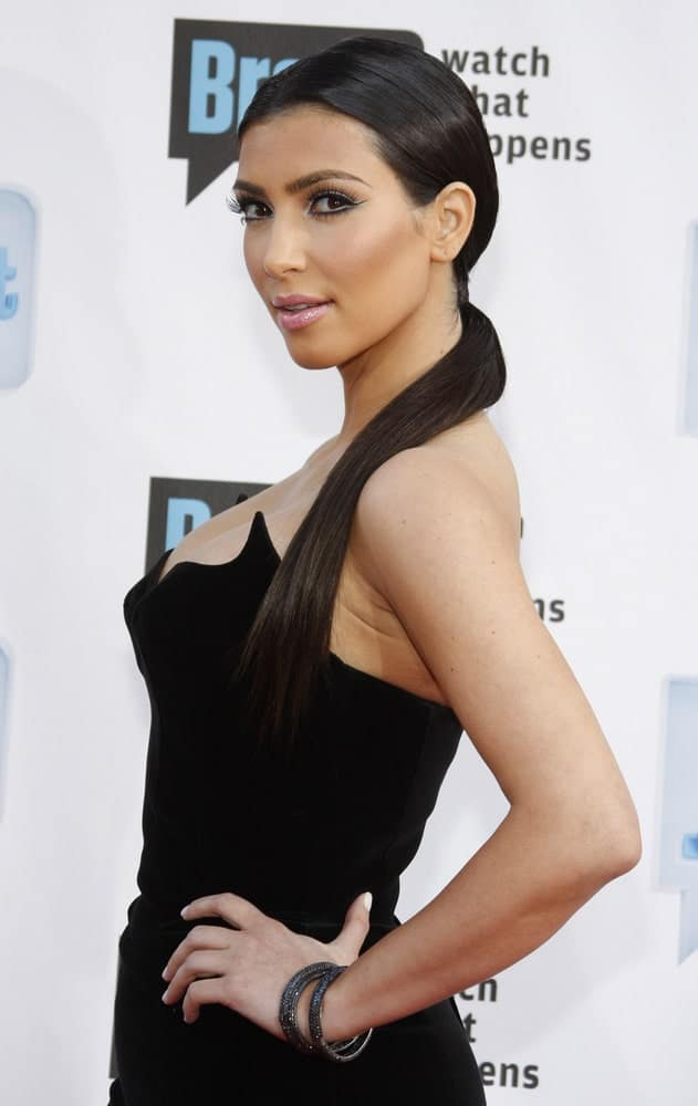 Kim Kardashian showcased her sleek low ponytail that perfectly matched her black dress at the 2009 Bravo's A-List Awards held at the Orpheum Theatre in Los Angeles on April 5, 2009.