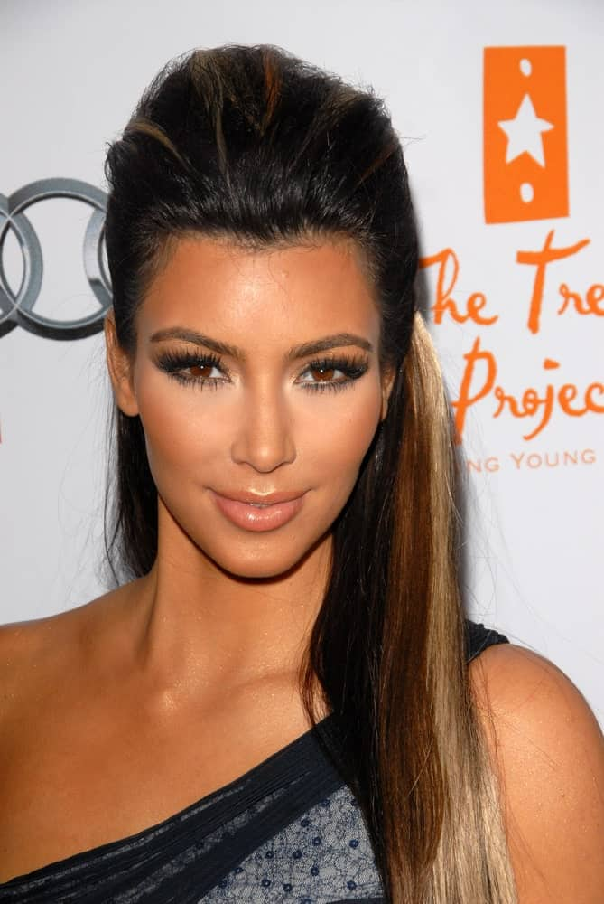 Kim Kardashian styled her highlighted locks with a pompadour half updo during The Trevor Project's 12th Annual Cracked Christmas on December 6, 2009.