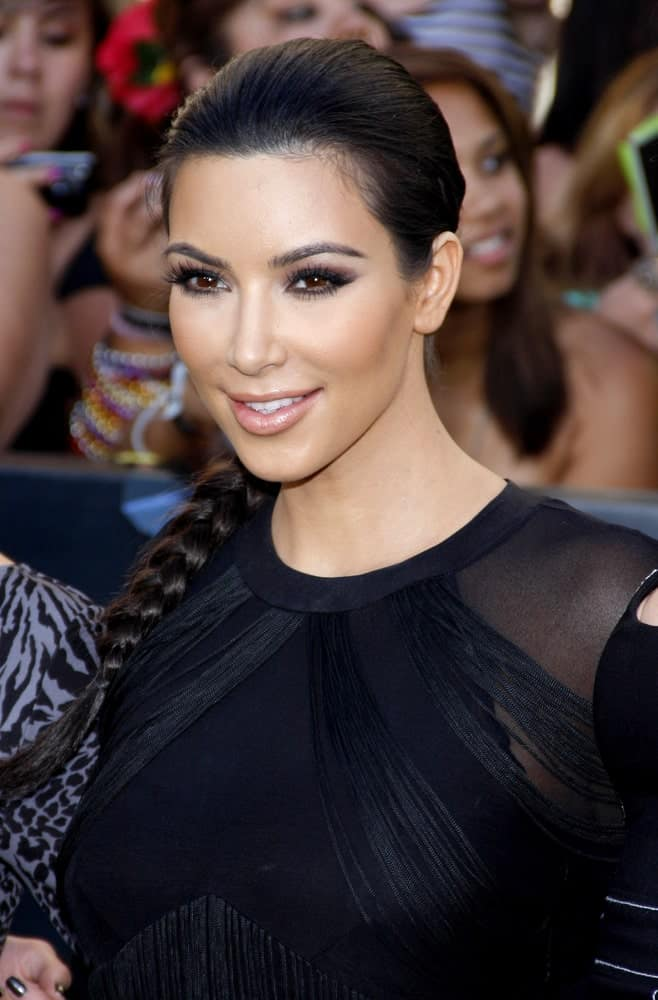 "On June 24, 2010, Kim Kardashian was spotted at ""The Twilight Saga: Eclipse"" Los Angeles Premiere held at the Nokia Live Theater in Los Angeles with her long jet black locks arranged into a sleek braided ponytail."