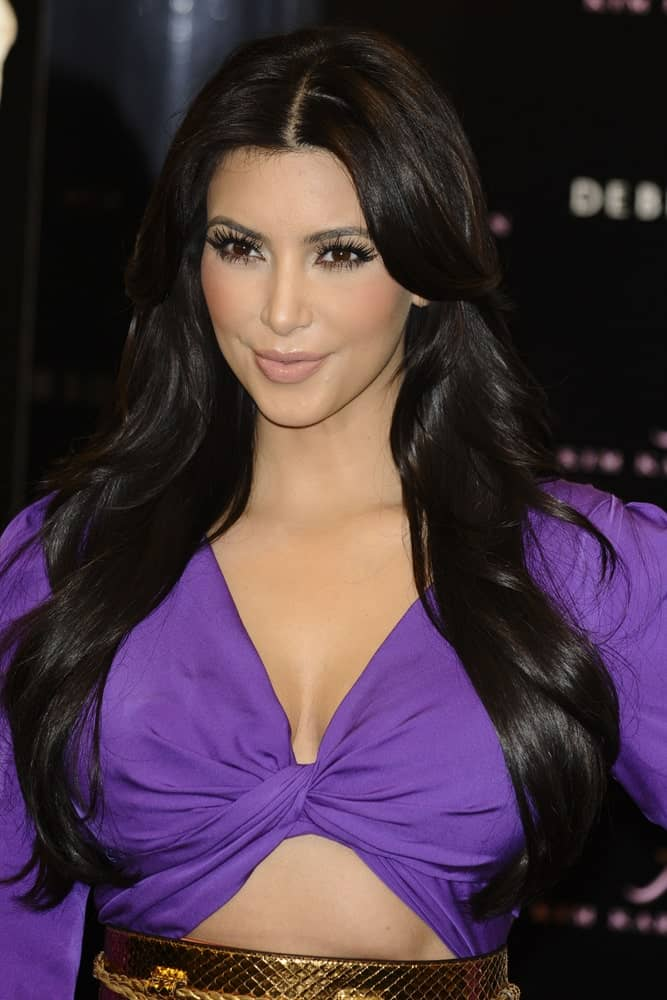 Kim Kardashian with her long layered raven waves as she signs bottles of her new perfume 'Kim Kardashian' at Debenhams, Oxford Street, London on August 6, 2011.