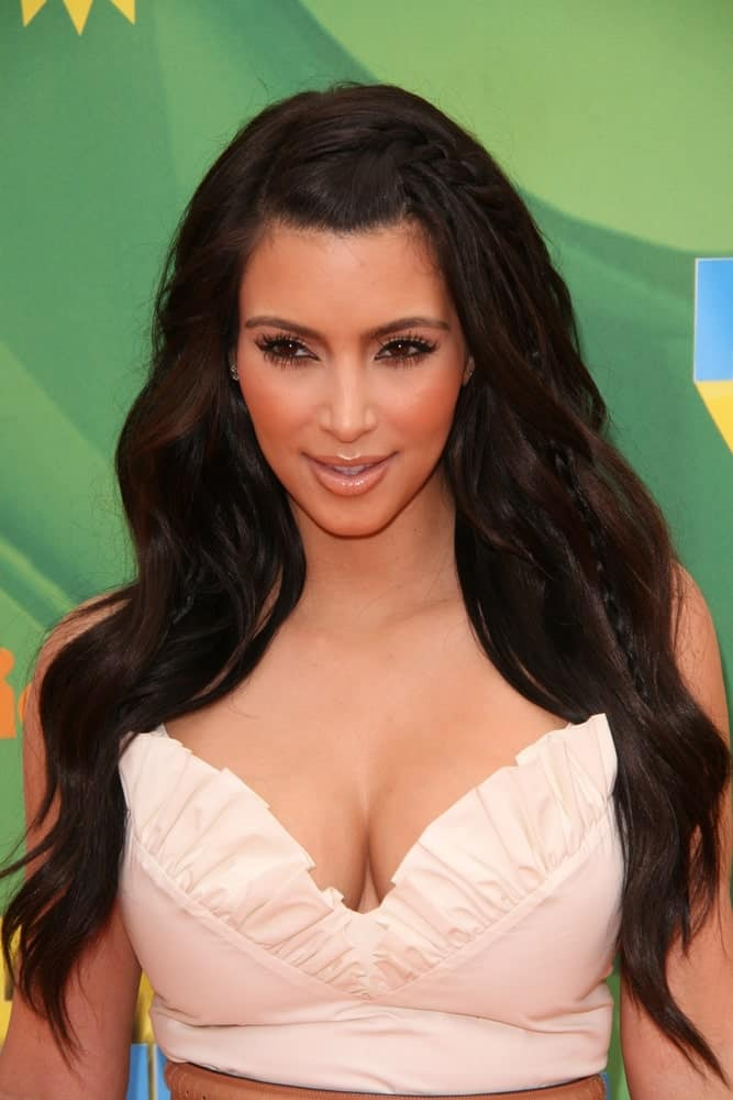 Kim Kardashian incorporates her long black waves with a side braid at the 2011 Kids Choice Awards at Galen Center, USC on April 2, 2011.
