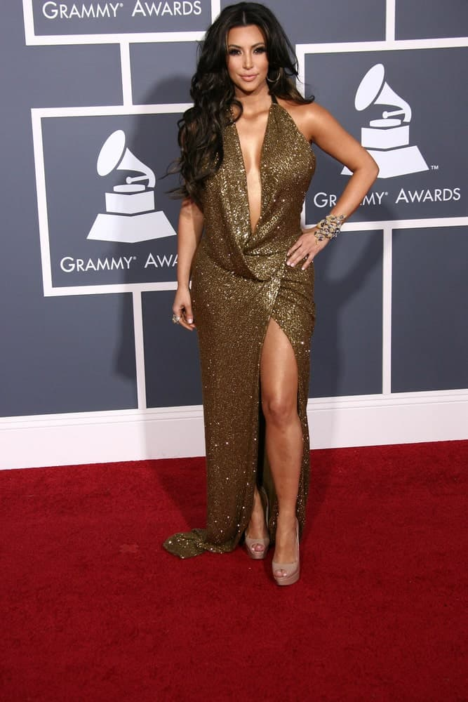 Kim Kardashian looked ravishing in a gold glitter gown that's complemented with her long center-parted waves at the 53rd Annual Grammy Awards held on February 13, 2011, in Staples Center, Los Angeles, CA.