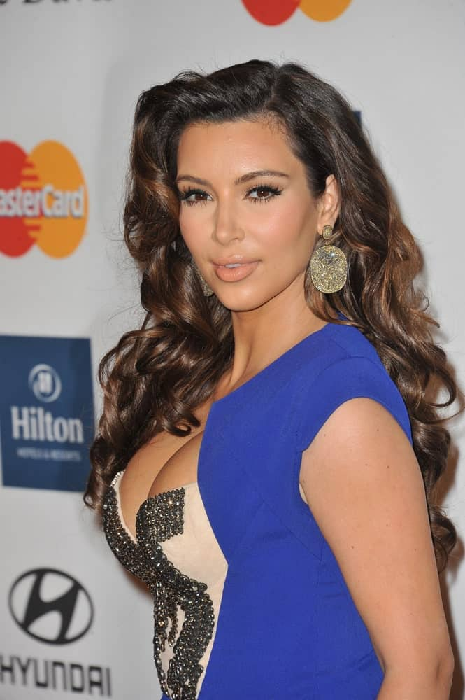 Kim Kardashian exhibited a sultry aura with her brunette side-swept curls at the 2012 Clive Davis Pre-Grammy Party at the Beverly Hilton Hotel last February 11, 2012.