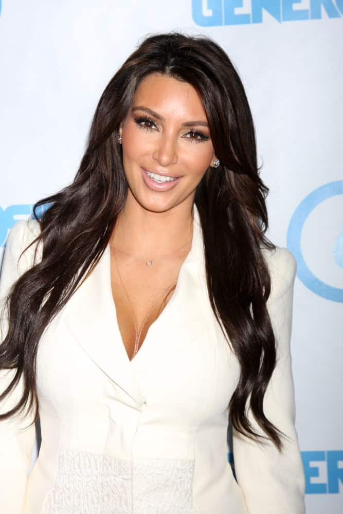Kim Kardashian looking sharp in a white suit contrasted with her black layered waves at the 4th Annual Night of Generosity Gala Event at Hollywood Roosevelt Hotel on May 4, 2012.