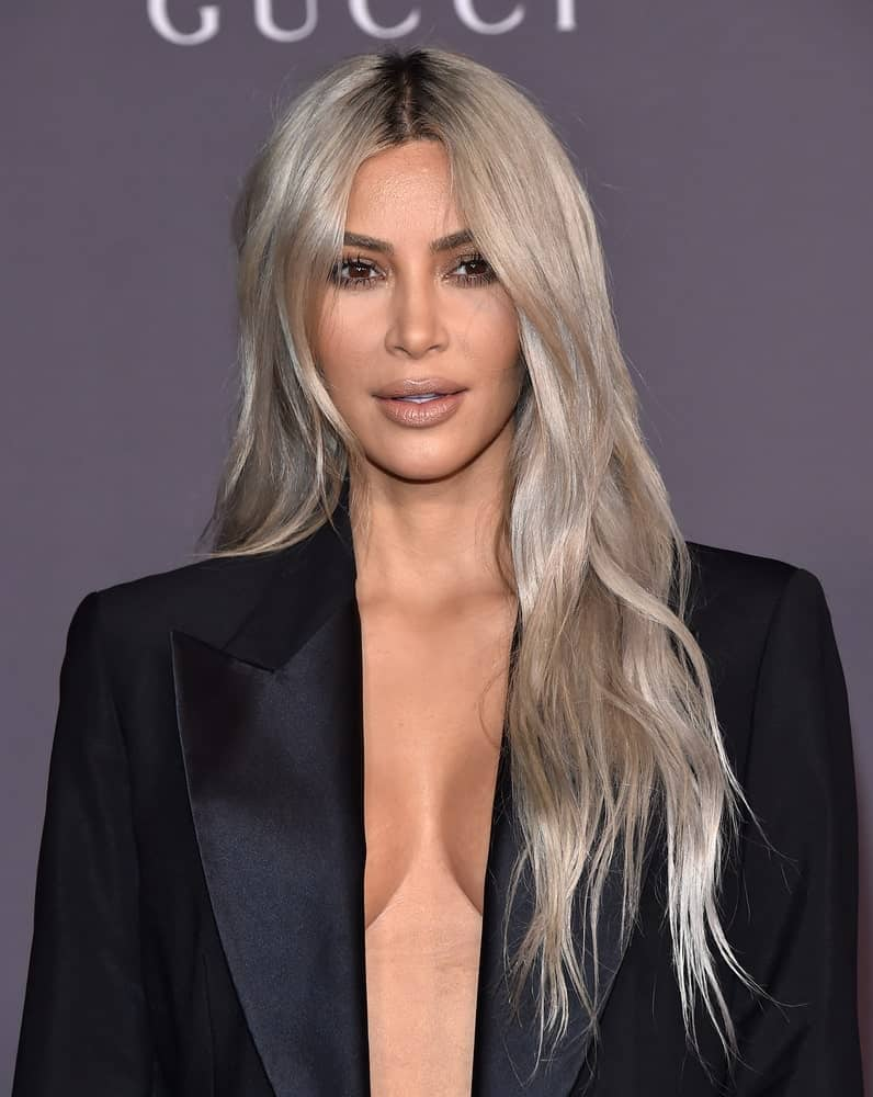 Kim Kardashian contrasts her black suit with silver-blonde loose waves during the 2017 LACMA Art + Film Gala on November 04, 2017, in Los Angeles, CA.