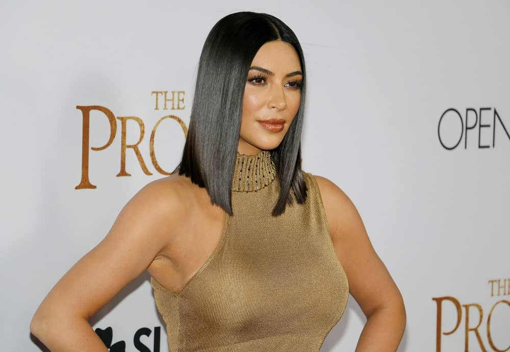 Kim Kardashian stuns in a skintight gold dress and wore her bob hair straight with a middle part just like an Egyptian Queen as she attends the Los Angeles premiere of 'The Promise'.