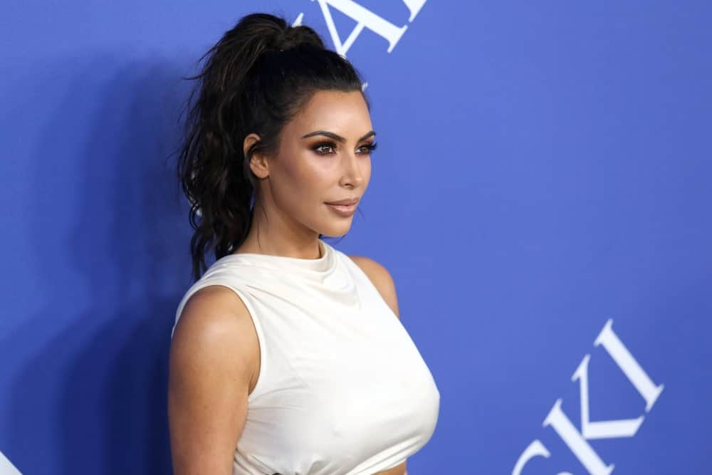 Kim Kardashian gathered her black hair in a tousled ponytail with side tendrils at the CFDA Awards at the Brooklyn Museum on June 4, 2018.