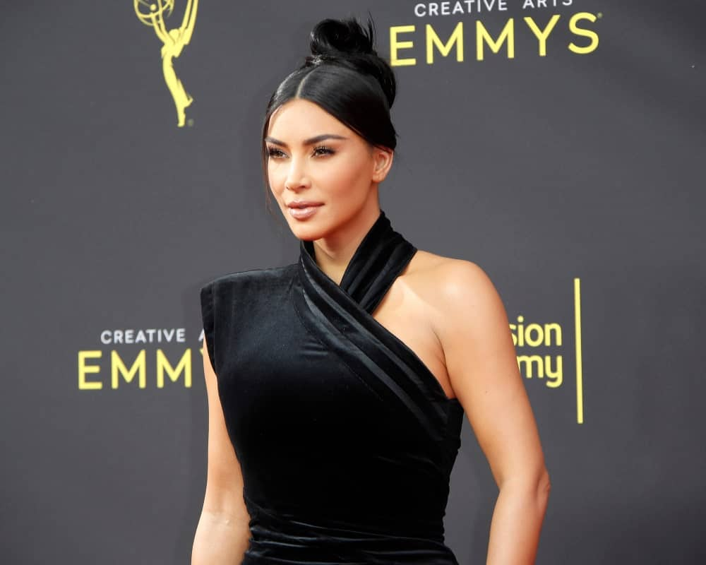 Kim Kardashian sported a slicked center-parted upstyle during the 2019 Primetime Emmy Creative Arts Awards at the Microsoft Theater on September 14, 2019.