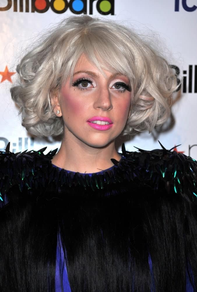 Lady Gaga was at the Billboard's Women in Music Brunch held at The Pierre Hotel in New York on October 2, 2009. She caught the attention of everyone with her unique blue dress with black details and her hair was styled with short tousled white-blond curls.