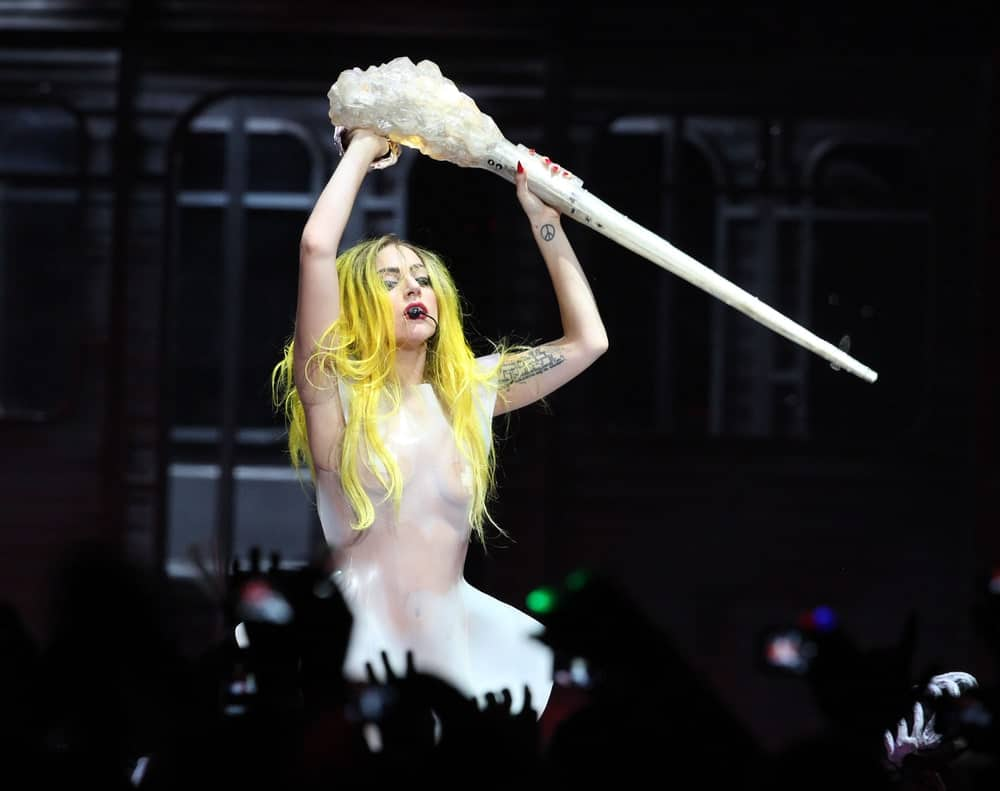 Lady Gaga performed at Staples Center on March 28, 2011, in Hollywood, CA. She looked like a mannequin in her white see-through latex outfit that makes her long, center-parted dyed yellow hair stand out.