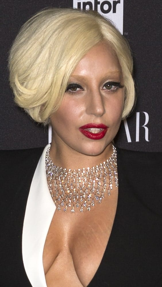 On September 05, 2014, Lady Gaga attended the Harper's Bazaar ICONS Celebration at The Plaza Hotel. She came in a lovely black and white smart casual outfit, gorgeous diamond necklace and a short tousled bob hairstyle.