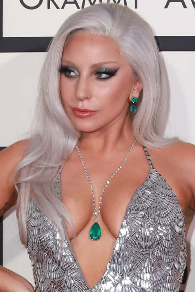Lady Gaga brought a little bit of the Broadway spirit with her at the 57th Annual GRAMMY Awards at the Staples Center on February 8, 2015. She wore a lovely silver dress that paired quite nicely with her silvery gray long side-swept hairstyle.