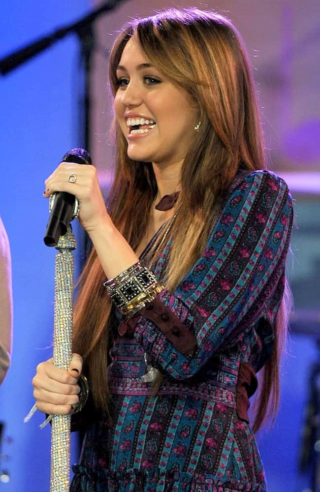 Miley Cyrus was on stage for ABC Good Morning America Concert with Miley Cyrus held at the Hard Rock Cafe in Times Square, New York on April 8, 2009. She wore a sweet colorful outfit that went well with her straight layered and highlighted long hair.
