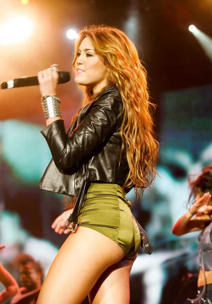 Miley Cyrus went with a long and wavy tousled hairstyle that has a reddish brown tone when she performed on main stage on Rock in Rio – Lisboa on May 29, 2010 in Lisbon, Portugal.