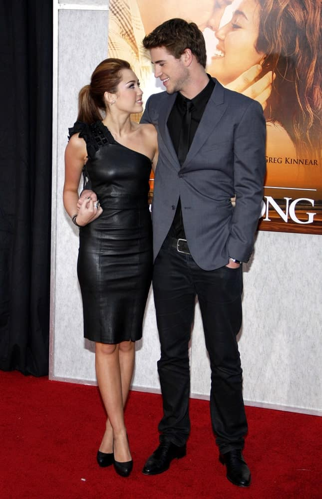 """Miley Cyrus and Liam Hemsworth were at the World Premiere of """"The Last Song"""" held at the ArcLight Cinemas in Hollywood on March 25, 2010. Cyrus was a picture of elegance in her black leather dress and neat highlighted ponytail."""